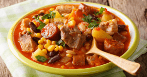 Slow Cooked Meat Stew with Corn, Beans and Vegetables