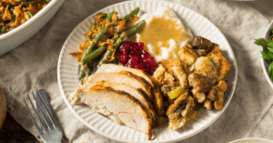 Thanksgiving Dinner with Turkey, Green Beans, Mashed Potatoes, Cranberry and Stuffing