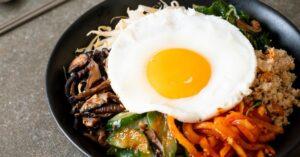 Bowl of Korean Bibimbap with Egg and Fried Rice