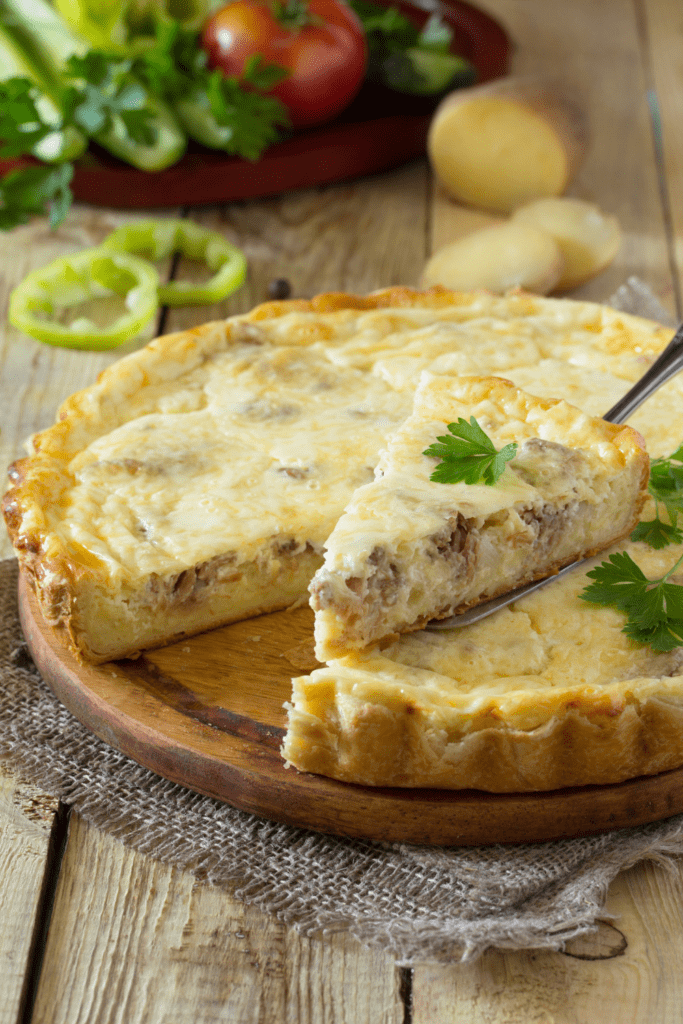 Breakfast Quiche Stuffed with Meat, Potatoes and Cheese