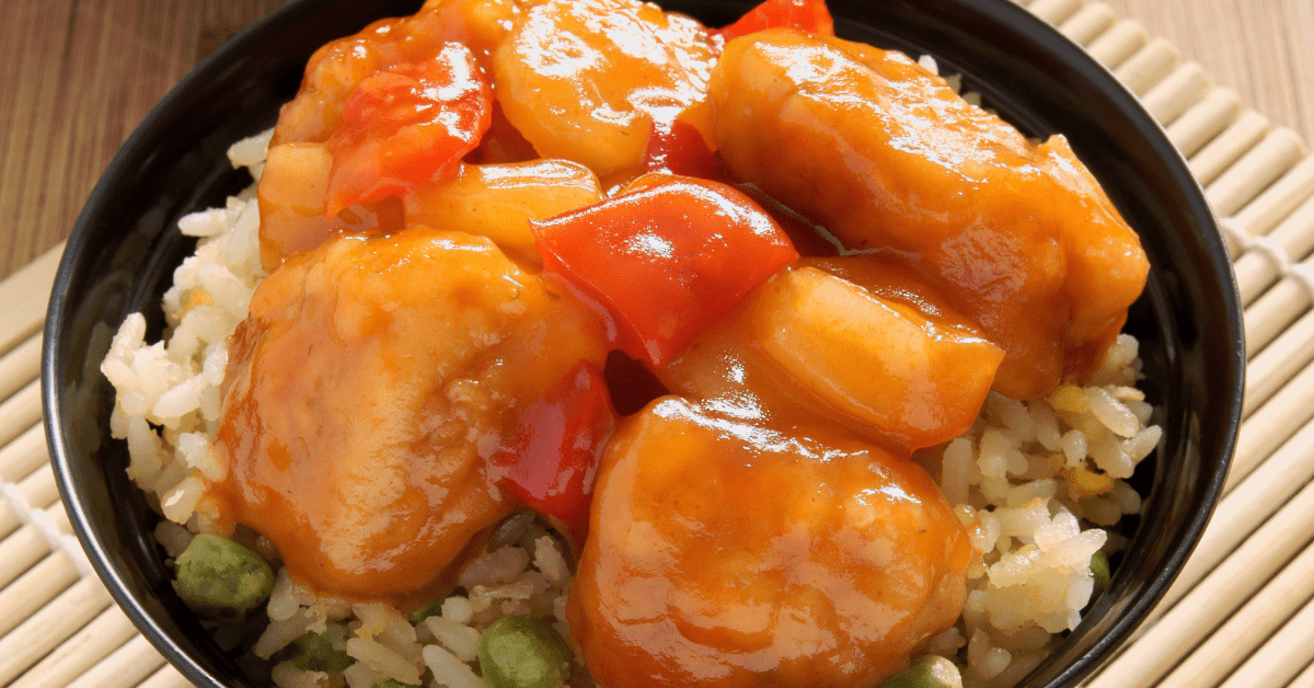 Egg Fried Rice Topped with Sweet and Sour Chicken Balls