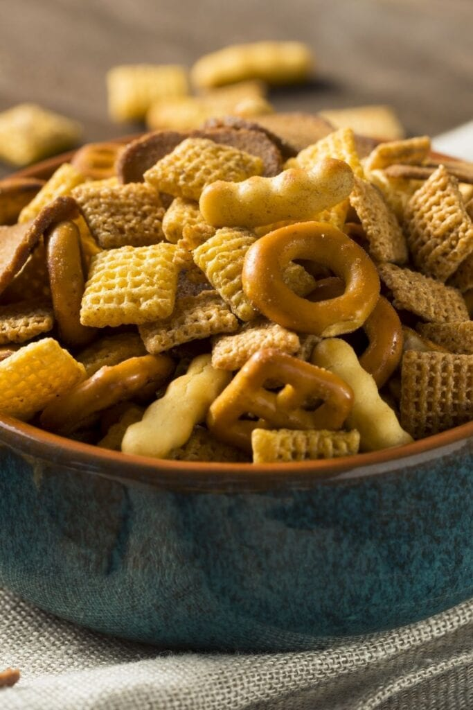 Homemade Snack Mix in a Bowl with Cereals and Pretzels