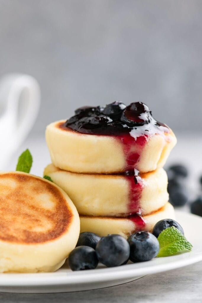 Snyrniki or Cheese Pancakes with Blueberry Jam