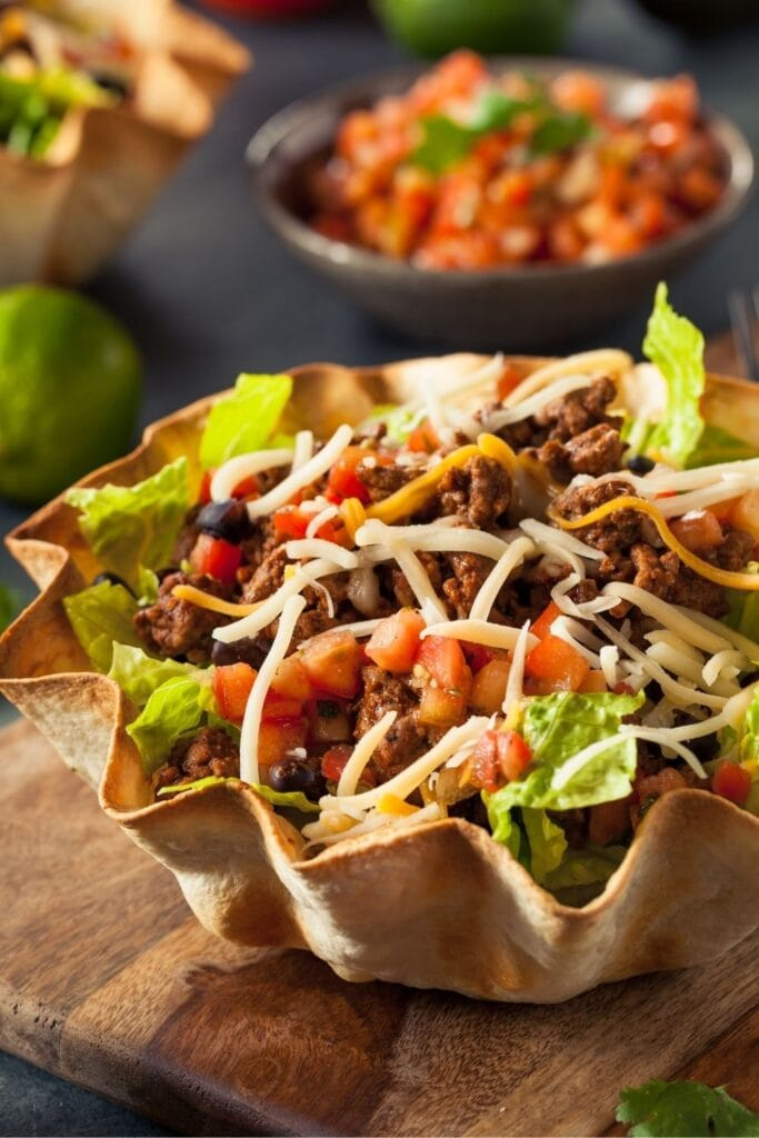 Taco Salad in a Tortilla Bowl with Cheese and Lettuce