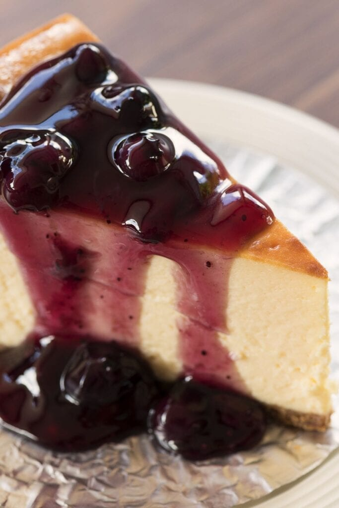 A Slice of New York Cheesecake with Blueberry Sauce