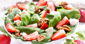 Bowl of Strawberry Spinach Salad with Feta Cheese and Pecan Nuts