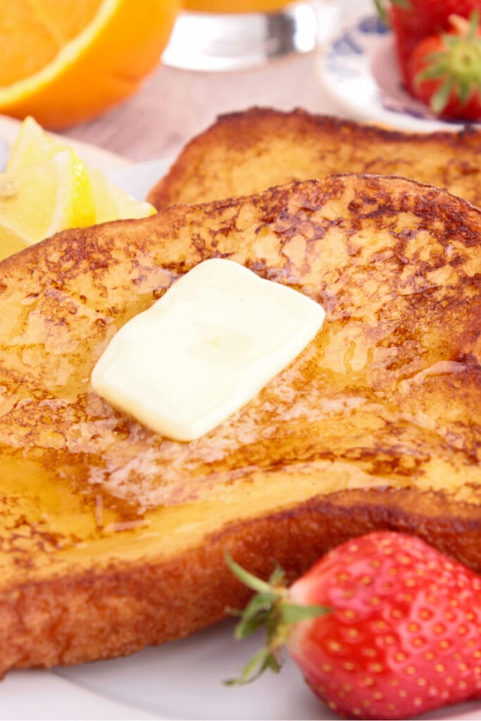French Toast with Butter and Strawberries