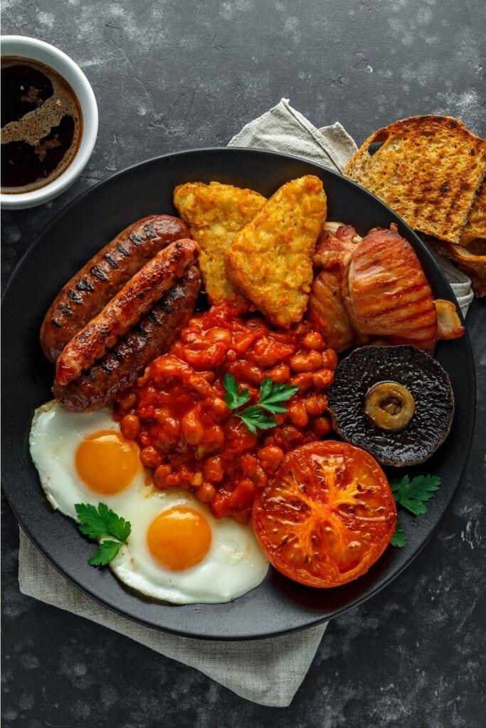 Full Irish Breakfast: Sausage, Hash Browns, Egg, Bacon, and Chickpeas