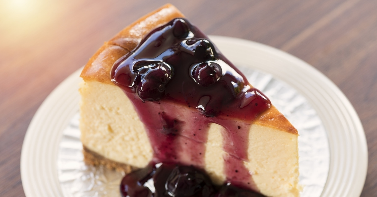 Homemade New York Cheesecake with Blueberry Sauce