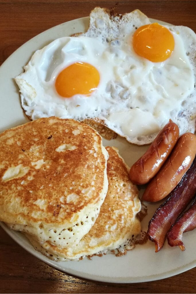 Eggs, bacon, sausage, and pancakes