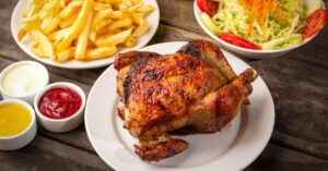 Peruvian Roasted Chicken with Dipping Sauce French Fries and Vegetable Salad