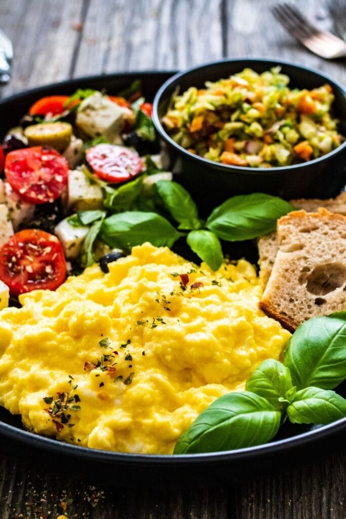 Scrambled Eggs with Greek Salad and Bread