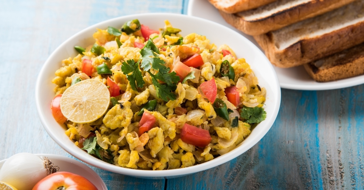 Spicy Scrambled Eggs in a Bowl with Toasted Bread