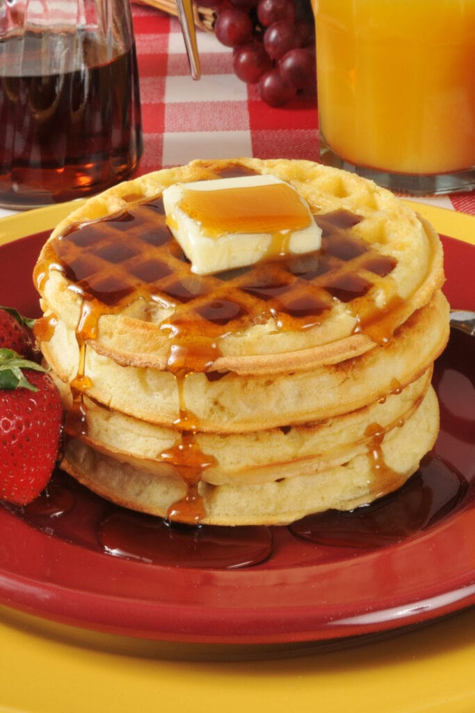 Buttered Waffles with Maple Syrup and Strawberries