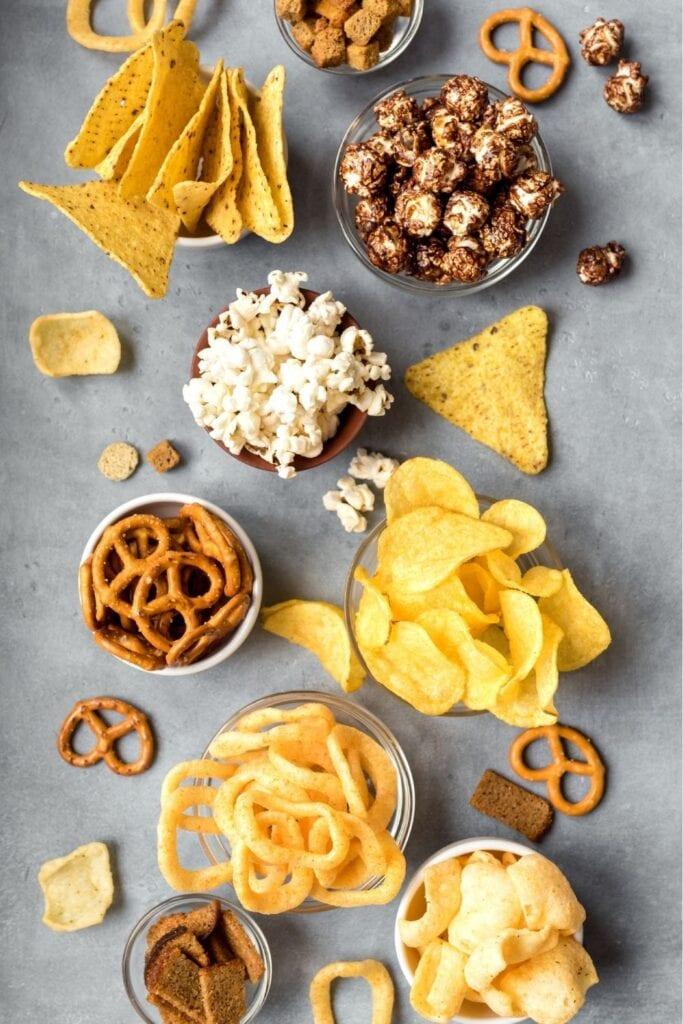 Assorted Snacks: Pretzels, Chips and Pop Corn
