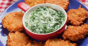 Bowl of Spinach Soup with Potato Pancakes