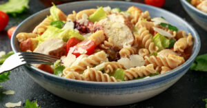 Caesar Salad Pasta with Chicken, Tomatoes and Cheese