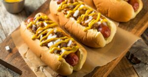 Chili Hot Dogs with Mustard Sauce and Onions