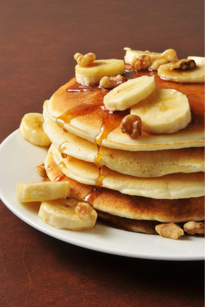 Coconut Flour Pancakes with Bananas and Syrup