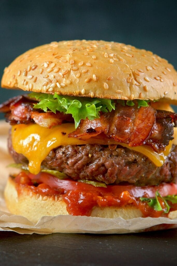 Hamburger with Crispy Bacon, Cheese, Tomato Sauce and Lettuce