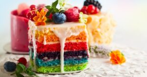 Homemade Colorful Rainbow Cake with Berries and Sugar Icing