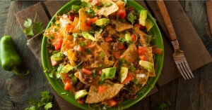 Loaded Beef and Cheese Nachos with Cilantro and Lime