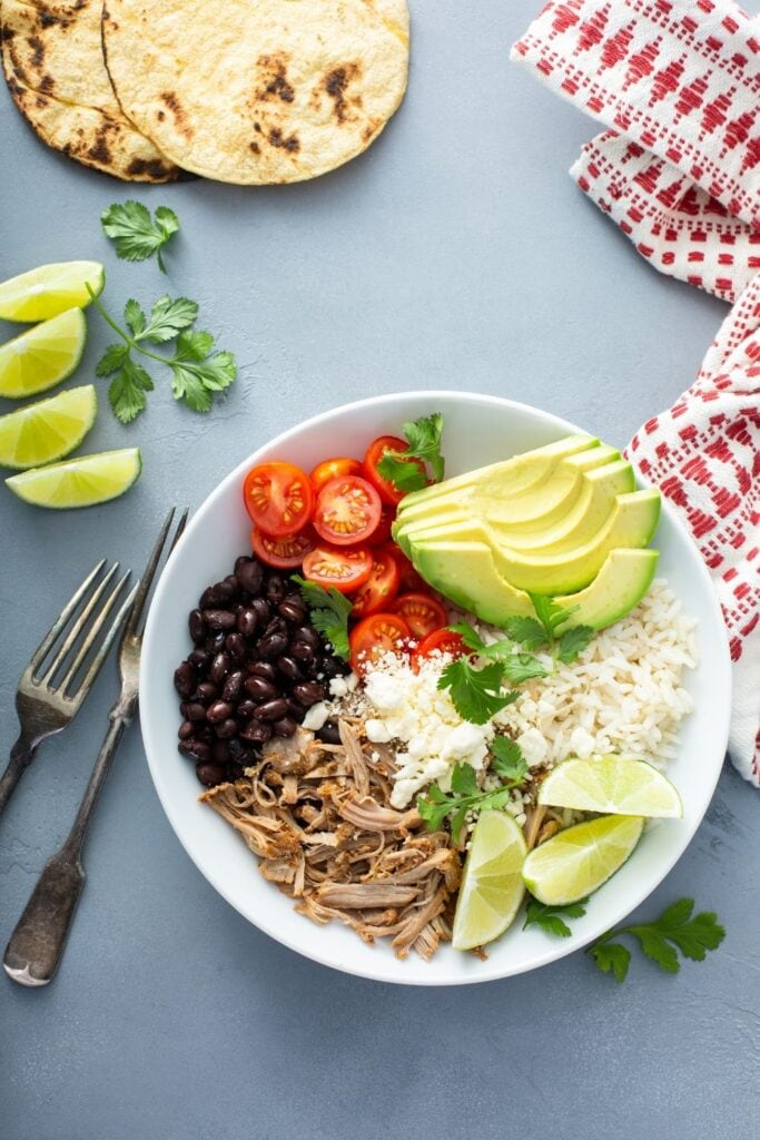 Mexican Burrito Bowl: Pork Carnitas, Black Beans, Tomatoes, Avocadoes, Lime and Rice