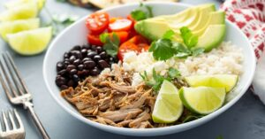 Mexican Pork Carnitas and Rice Bowl with Fruits and Vegetables