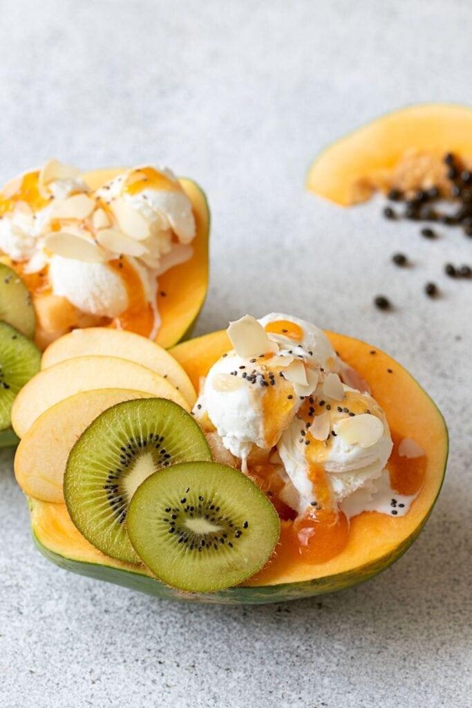 Papaya Boat Dessert with Ice Cream, Kiwi and Apples