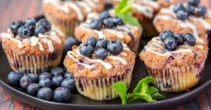 Blueberry Muffins with Vanilla Frosting and Fresh Blueberries