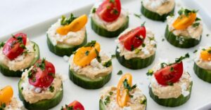 Cucumber Bites Topped with Hummus and Cherry Tomatoes