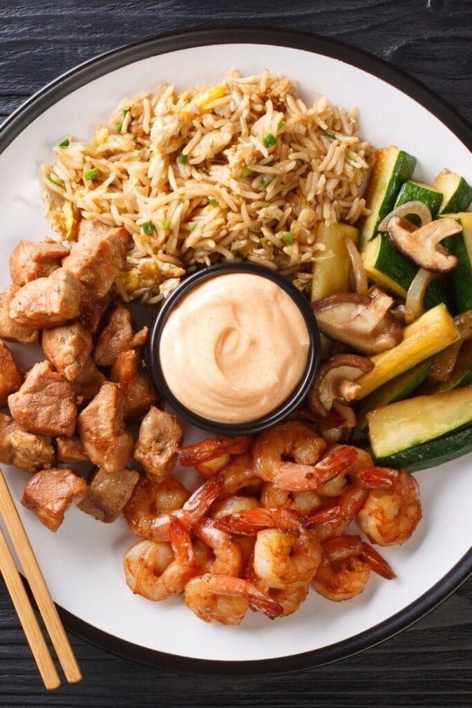 Hibachi Dish: Fried Rice, Steak, Zucchini, Shirmp and Yum Yum Sauce