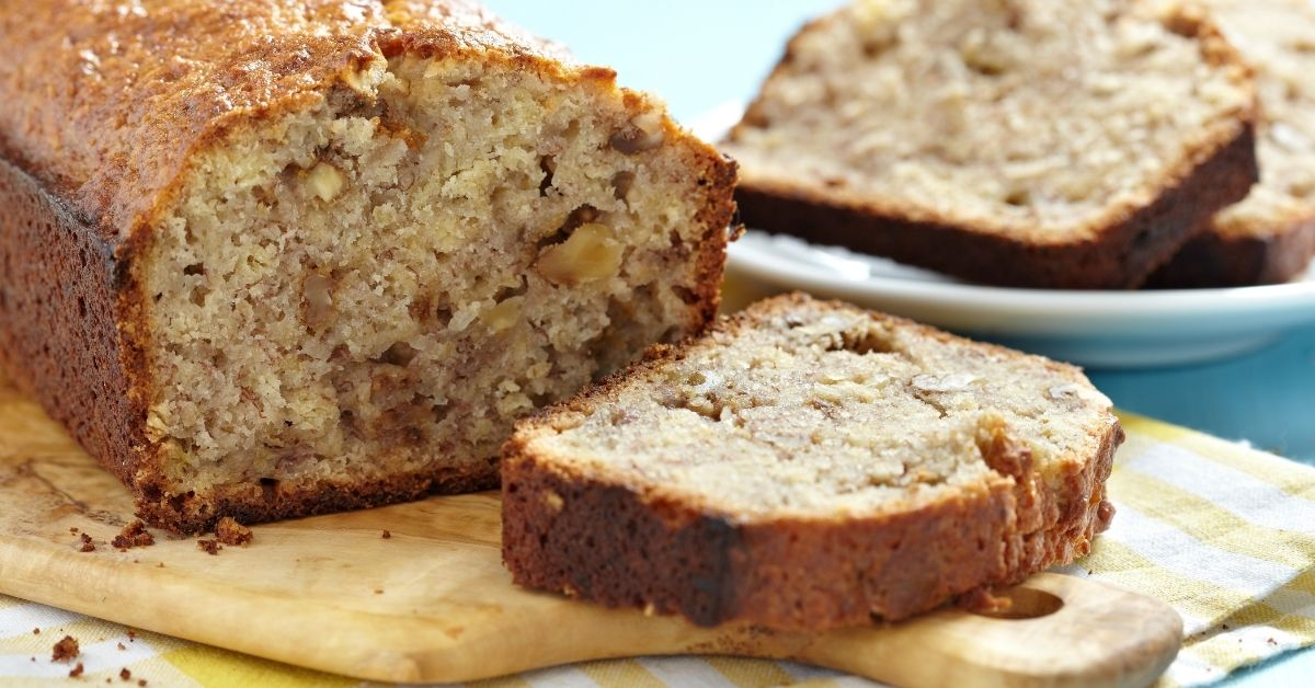 Homemade Banana Bread with Nuts Sliced in a Chopping Board