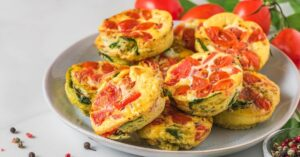 Homemade Egg Muffins with Tomatoes and Spinach on a Plate