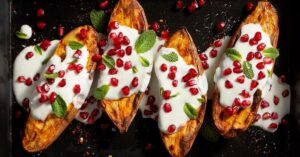 Homemade Sweet Baked Potatoes with Yogurt Sauce and Pomegranate Seeds