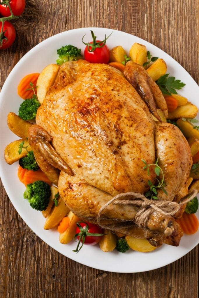 Roast Chicken with Roasted Vegetables on a Plate