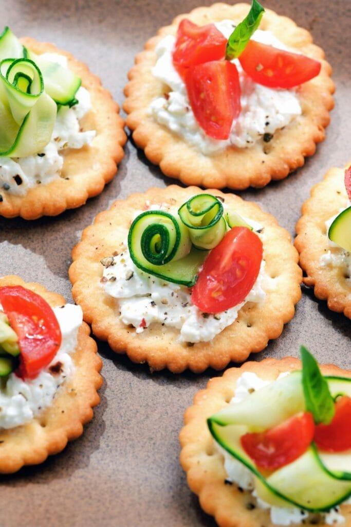 Saltine Cracker Bites with Ricotta Cheese, Zucchini and Tomatoes