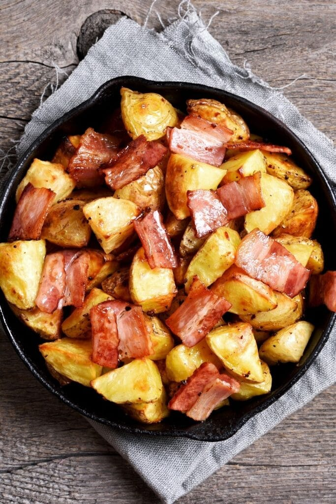 Fried Potatoes and Bacon in a Skillet
