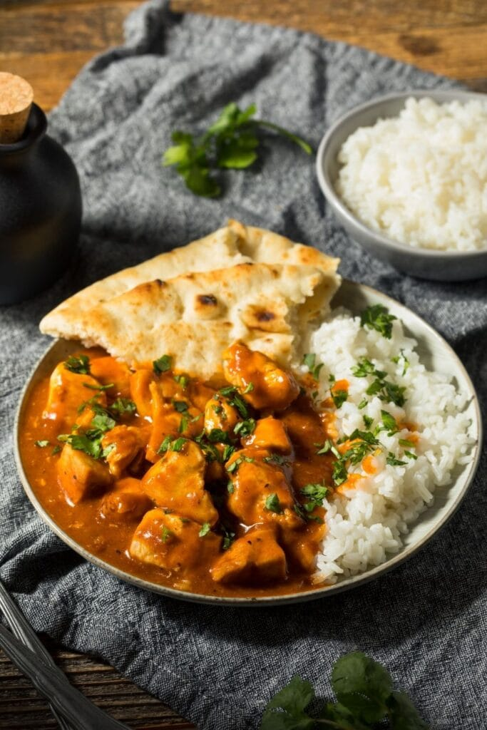 Homemade Butter Chicken with Naan Bread and Rice