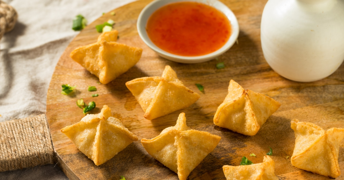 Homemade Deep Fried Rangoon with Chopped Onions and Dipping Sauce