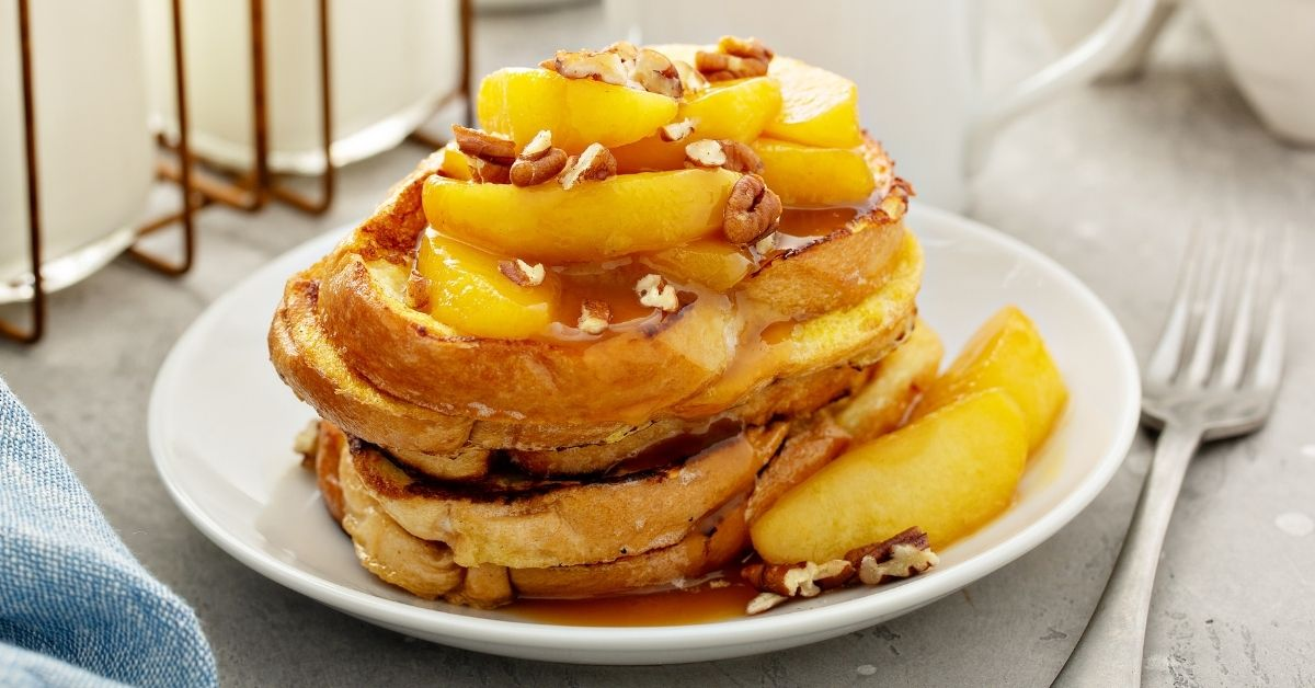 Homemade French Toast with Fried Apples, Nuts and Maple Syrup