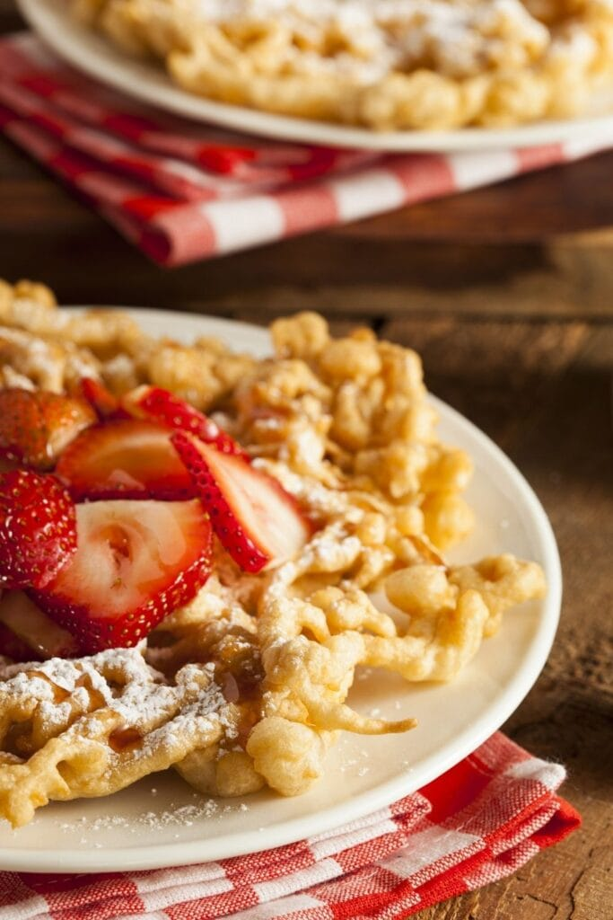 Funnel Cakes with Strawberry and Powedered Sugar