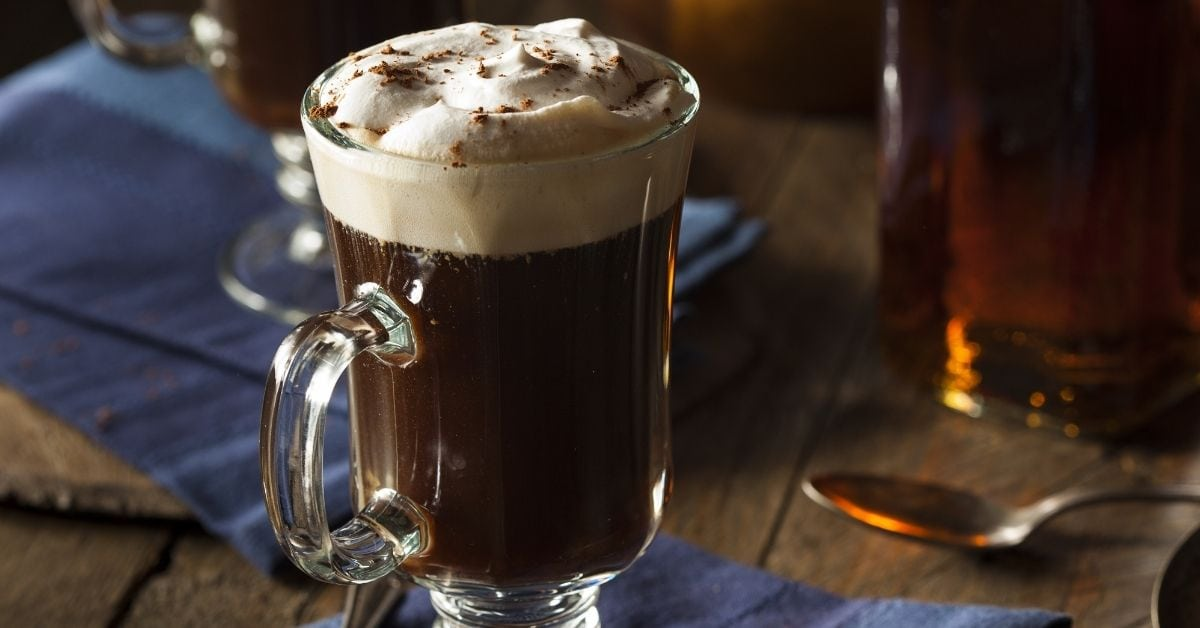 Homemade Irish Coffee with Whipped Cream in a Glass