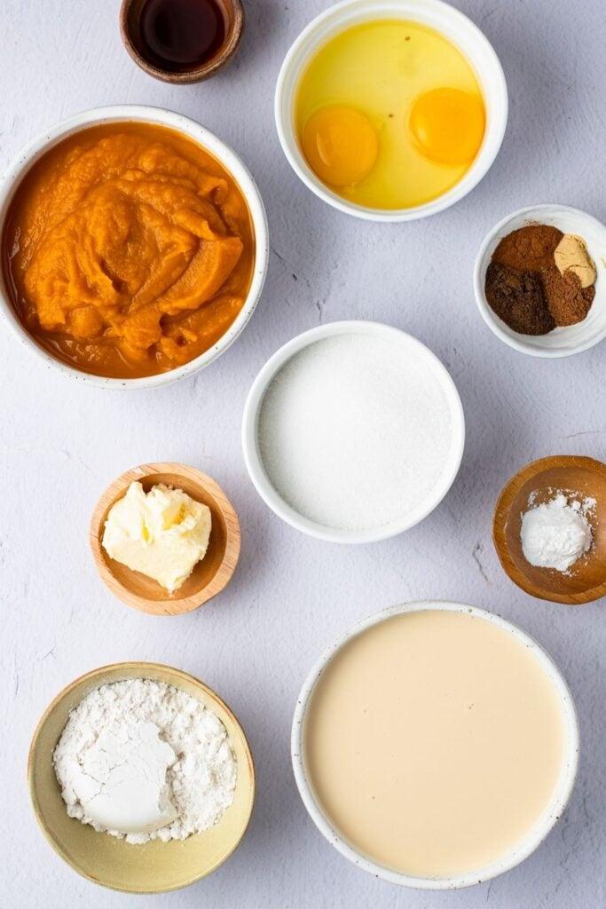 Impossible Pumpkin Pie Ingredients: Pumpkin Puree, Eggs, Butter Spices, Evaporated Milk, and Ground Nutmeg
