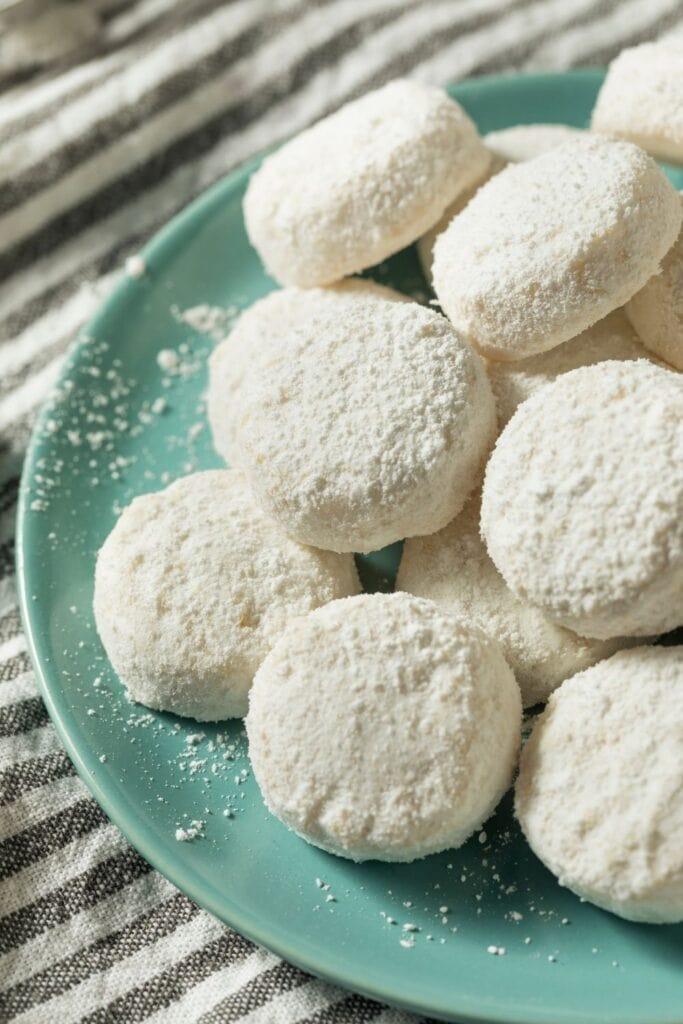 Italian Wedding Cookies in a Green Plate