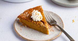 Slice of Homemade Pumpkin Pie with Whipped Cream