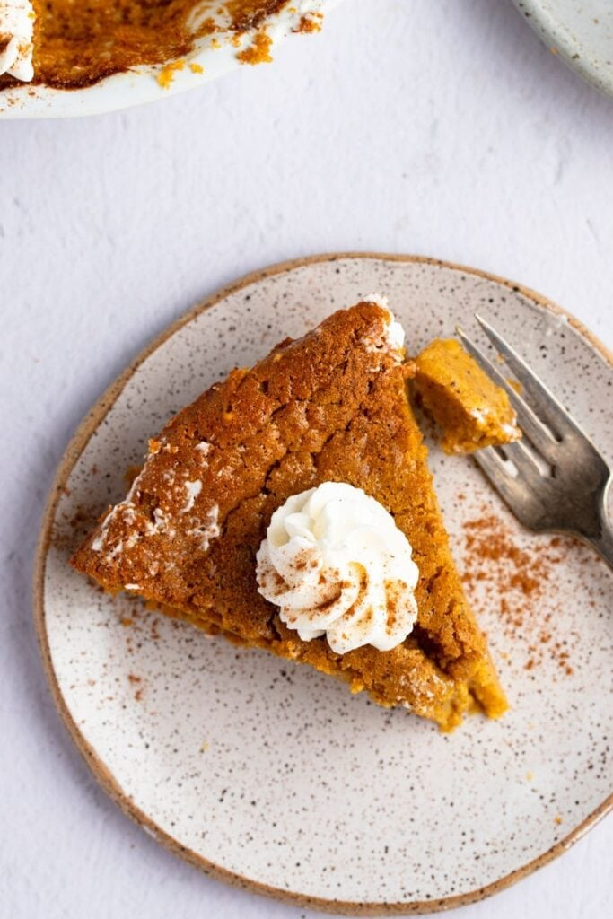 Slice of Impossible Pumpkin Pie in a Plate