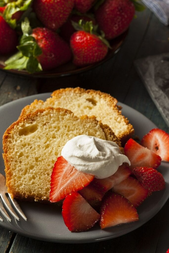 Slices of Pound Cake with Strawberries and Whipped Cream