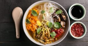 Warm Chinese Noodle Soup with Mushrooms and Vegetables