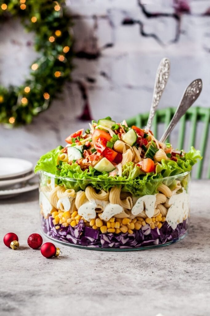 Layered Pasta Salad with Red Cabbage, Corn, Tomatoes, Cucumber and Herbs